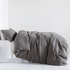 The Soft Washed Duvet Cover and Sham Set is defined by casual comfort. Featuring a cool slate grey shade that is complimented by the warm lived-in feel of the washed 100% cotton, will want to live in this soft fabric. While this versatile style can be used as a neutral base in a variety of looks, it can also stand alone as a minimalist statement piece. Includes duvet cover and sham(s). Inserts sold separately.