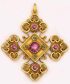 Jeweled cross pendant.