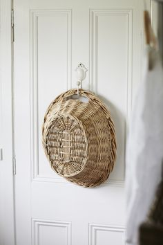 Simple but cute idea - laundry basket on an antique hook behind the door.