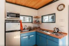 A look at Shaye and Tom (and their newborn) and their tiny house on wheels after one year living tiny in it. Also their tiny house plans are now available. Tiny House Talk, Modern Tiny House, Tiny House Plans, Tiny House On Wheels, Tiny Apartments, Tiny Spaces, Houses In Austin, Murphy Bed Plans, Small Room Design