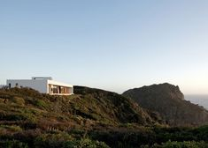 Perched on a clifftop along the Chilean shoreline, this idyllic residence by architecture studio L2C forms part of a self-sustaining community that produces its own energy and water, and deals with its own waste