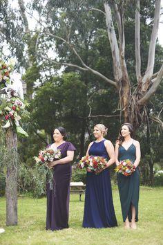 Mismatching bridesmaids dresses jewel tones