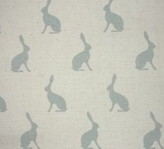 Mini Hares Fabric A printed fabric with gently faded hares in duck egg on a natural linen.