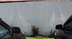 Sketsa mirip Tuhan Yesus di Dinding Pagar GMIM Setia Kudus Pondang