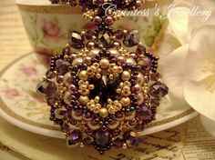 Purple and gold beaded necklace with pendant smoky quartz
