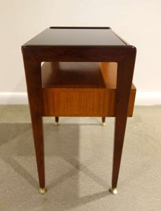 Pair of Italian Mid-Century Modern Two Tier Night Stands | From a unique collection of antique and modern night stands at http://www.1stdibs.com/furniture/tables/night-stands/