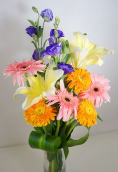 Desdemona - This vivid and ordinary arrangement is blend from the freshest silky white asiatic lilies, tangerine orange and ballerina pink gerberas, its beauty will fill a room with color. Perfect in every occasion. Vase Not Included.