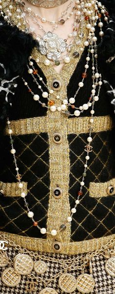 Today, we need to wear layers and layers of pearl jewelry.   Chanel Fall 2015