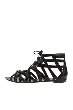 """Add a splash of sass to your look with the Loved Up jelly sandals. Details include a strappy upper and lace up front. This will be the """"it"""" item for your trip to the beach or pool.   Loved Up Sandals by Dirty Laundry. Shoes - Sandals Miami, Florida"""