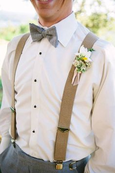 We love a heather grey tuxedo with tan suspenders. This is perfect for spring and summer weddings! #alexaclaire #summerwedding #springwedding #weddinginspiration