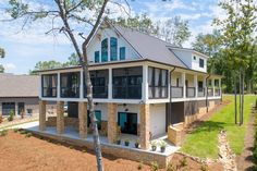 Exclusive Show-Stopping Vacation Home Plan with 3-Sided Wraparound Porch - 18302BE | Architectural Designs - House Plans Lake House Plans, Dream House Plans, House Floor Plans, Dream Houses, Rustic Lake Houses, Open Space Living, Living Spaces, Porch Plans, Lakefront Homes