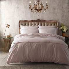 Add delicate design to your bedroom with this Cotlin duvet cover from Ted Baker. In on-trend blush pink, this duvet cover is beautifully simple in design and is finished with subtle button detailing.
