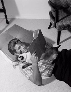 A young Michael Landon reading with his cat. #michaellandon www.OneMorePress.com
