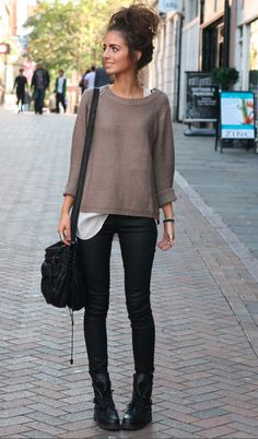 Cute and laid back outfit for the fall with the large oversized sweater, white shirt underneath, black jeans, combat boots, and a top bun.