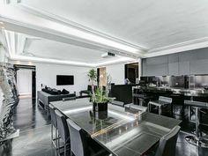Black open kitchen / dining / living - Daniel Féau Conseil Immobilier