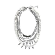 Pearl + Crystal Spike Drama Necklace $128  Elevate your look with a layered, slightly twisted pearl and chain torsade, featuring clear crystals and black diamond crystal spikes. A collar of black diamond glass rhinestones, handset in brass settings, add to this covetable mix of feminine and edgy materials. Let your soft and tough sides sparkle and shine in this one-of-a-kind piece.  Chloe+Isabel.com