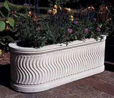 The hypnotic strigillated pattern, narrowly spaced wavy flutes, of this cast stone trough enhances its elegant classical shape. Stone Planters, Cement Planters, Garden Planters, Tulasi Plant, Balcony Railing Design, Contemporary Planters, Container Plants, Plant Containers, Cast Stone