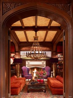 Beautiful #Brown wood paneled Library. I love the pop of Purple and Orange to bring life to a dark Library #ManCave by Ken Fulk  Live Beautifully!
