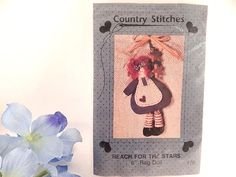 """Rag Doll Wall Hanging Sewing Craft Pattern 6"""" raggedy ann style doll Vintage 1992 Country Stitches pattern, made in the USA Cut pattern, gently used, includes two (2) wooden stars  For additional vintage treasures please visit my companion shops ..."""