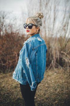 Top knot + distressed denim.