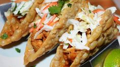 Ground chicken is topped with homemade coleslaw in these clever chicken wonton tacos for a fun Asian- and Mexican-inspired meal.