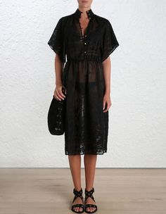 Sakura Kimono Dress, from our Summer Swim 16 collection, in Noir silk cotton organdie with cotton embroidery. High neck dress with button-down front and wide kimono sleeve. Scalloped edge trim at sleeve and hem. Side seam pockets at hip, elastic waistband.