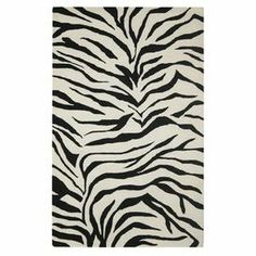 Hand-tufted wool rug with a zebra-print motif.  Product: RugConstruction Material: WoolColor: Black and ivoryFeatures: Hand-tufted Note: Please be aware that actual colors may vary from those shown on your screen. Accent rugs may also not show the entire pattern that the corresponding area rugs have.