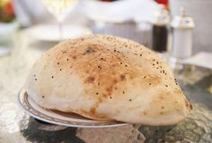 Turkish 'Lavaş' (lah-VAHSH'), sometimes called 'balloon bread,' is thin and crispy and puffs up high as it cooks. It's served piping hot with a hollow center full of steam as an appetizer before kebab meals along with Turkish 'tulum' goat cheese, chunks of unsalted village butter and spicy tomato and pepper crush called 'ezme' (ez-MAY').