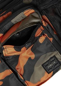 Porter - Yoshida   Co. Camo Waist Bag in Orange. Two front pockets with  press stud closure. 1958064b94125