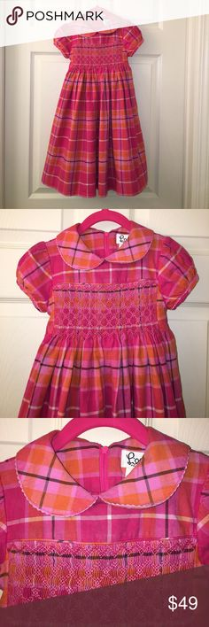 Lilly Pulitzer Girls Pink Plaid Smocked Dress sz 5 Oh my! Another Lilly for sale! This is a Lilly Pulitzer Girls Pink Plaid Smocked Dress in a sz 5, dress has a back zip and sash! Its lined and has the Lilly lace hem too! Good used condition! I ship fast! Happy poshing friends! Lilly Pulitzer Dresses Formal