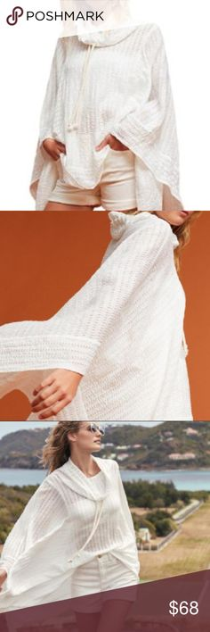 Anthropologie white Lilka shell beach poncho cape NWT. Brand new with tags attached! White eyelet poncho/cape. Pullover styling with drawstring neckline. Measures 29 1/2 inches from shoulder to hem. Thanks for looking and make an offer.💕 Anthropologie Sweaters Shrugs & Ponchos