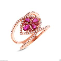 Flirty and floral #RoseGold Ring with Natural Red #Rubies and #Diamonds: http://sagedesignsla.com/diamond-rings/fashion-cocktail/natural-womens-1-14-ct-14k-rose-gold-pear-round-cut-ruby-diamond-cocktail-ring.html