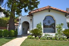 Spanish Revival - gorgeous arched window, and look closely at the details - nicely done...