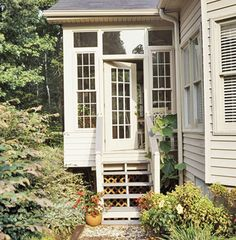 this is the back porch of my dreams. The multi-light windows and door, the transom over the door. It looks small, but it's fine for a back porch.