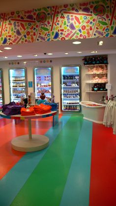 Dylan's Candy Bar is a candy store based in New York City. It owns its own line of candies and chocolate, and stocks other brands as well, including M, PEZ, Dubble Bubble, Wonka, and Jelly Belly. In addition to candy and chocolate, candy-themed clothing can be purchased here. Many places also sell ice cream or ice cream floats. The store is owned by Dylan Lauren, daughter of designer Ralph Lauren.