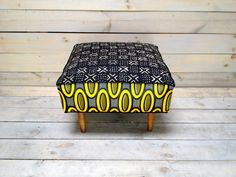 Mali Mudcloth and African Dutch Wax Cotton Upholstered Ottoman via Etsy