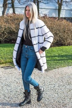Sarah Harris wears skinny jeans, lace-up boots, and a faux fur striped coat
