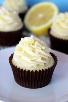Lemon Cream Cupcakes--start with a cake mix...and add fresh lemon juice and sour cream, along with other ingredients. Add lemon glaze after baking, then top with cream cheese frosting.  Yummy!