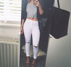 Ripped white jeans, tied grey shirt