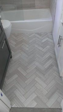 "Chevron floor tile draws you in to a small bathroom. MB // Bathroom - 12"" x 24"" Valentino Gray Marble Walls / Floor contemporary bathroom"