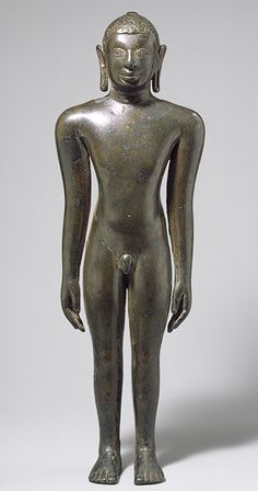 """Standing Jain tirthankara, 9th C. Tamil or Nadu India Copper alloy Nude a uniquely Jain form. In the standing posture of """"body abandonment"""" with arms unsupported by the body. This physically exacting pose is the most extreme expression of Jainism's central premise, ahimsa, """"nonviolence"""" to all living creatures. To maintain complete immobility to ensure no harm to any creature. Jainism predates Buddhism and rivals Hinduism's claim to be India's oldest continuously practiced faith."""