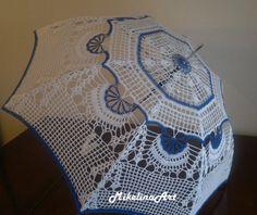 Mikelina Art sells several #crochet umbrellas on Etsy.