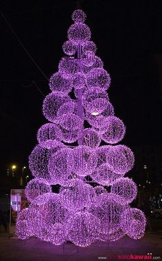 Tree made of purple lights.