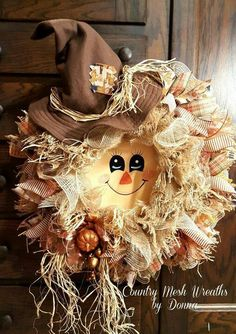 Scarecrow wreath...SO.STINKING.CUTE                                                                                                                                                                                 More