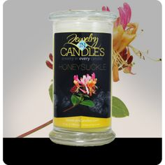 "Childhood memories of summers spent looking for the perfect honeysuckle bush... now you can have that same scent ""bottled up."" This scent starts with a strong floral bouquet, adds hints of pear and cassis, and finishes with a sweet cotton candy note. Honey Suckle Candle​   Infused with natural lemon, neroli, and petitgrain essential oils. Full size 21oz scented candle 100% all natural Soy candle  Burns for 100 to 150 hours.  Includes a surprise piece of jewelry in every candle."