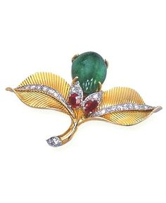 AN 18K GOLD AND MULTI-GEM CLIP BROOCH, BY CARTIER Designed as a flower, with a drop-shaped cabochon emerald bud with single-cut diamond and cushion-shaped ruby detail, to the ribbed gold leaves, enhanced by single-cut diamonds, circa 1950, with French assay marks for gold and platinum Signed Cartier, Paris, no. 010812