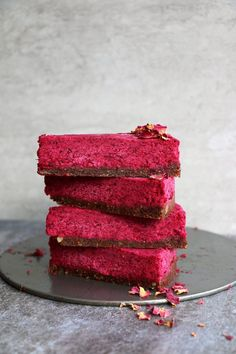 Enjoy this bright red raw vegan Beetroot Cake with Walnut and Fig Crust (grain-free & vegan). Get the recipe and delight (and shock) your guests with this delicious vegan dessert recipe.