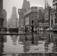 """rainy times sq. 1941    New York, March 1943. """"Times Square on a rainy day."""" Medium-format nitrate negative by John Vachon for the Office of War Information.  By syscosteve"""