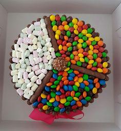 Chocolate Wheel. Chocolate cake, Chocolate frosting, choc fingers, Mnm's, Skittles, Mini marshmellows, Pink bow, Happy birthday Jamilla