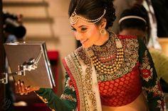 Indian bride wearing bridal lehenga and jewelry. Indian Bridal Lehenga, Indian Bridal Wear, Asian Bridal, Indian Bridal Fashion, Indian Wear, Big Fat Indian Wedding, South Asian Wedding, Indian Weddings, Indian Dresses